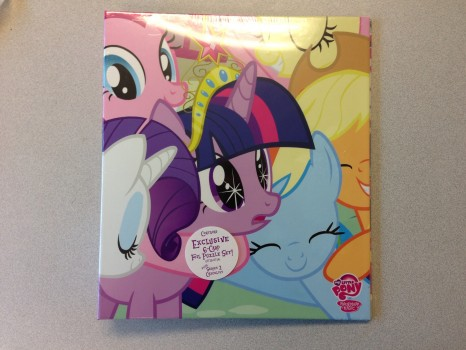 Front of the binder with plastic wrap.
